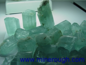 Aquamarine milk rough crystal in transmitted light